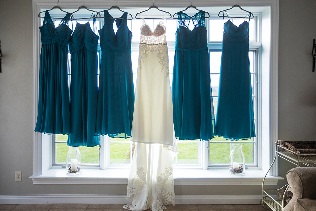 bride and bridesmaids dresses hanging