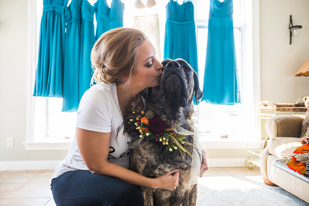 bride kissing her dog on a wedding day