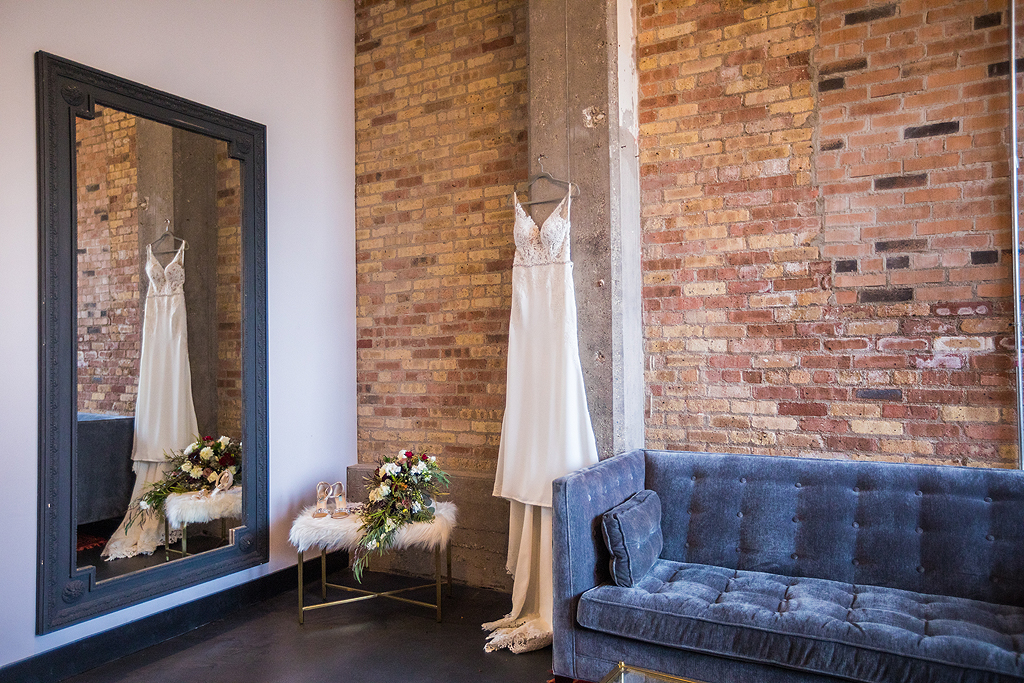 brides dress hanging in the bridal suite at the standard