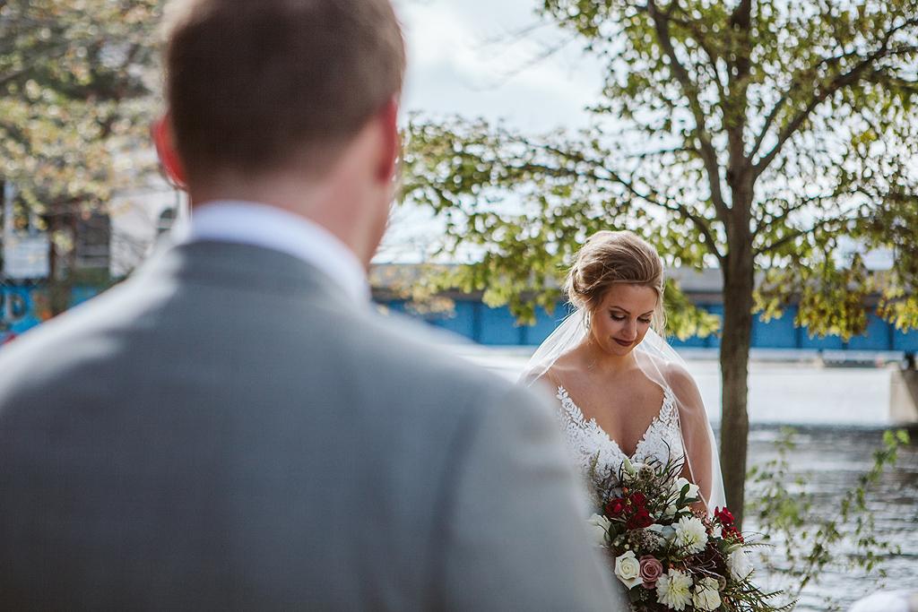bride looking her wedding flowers