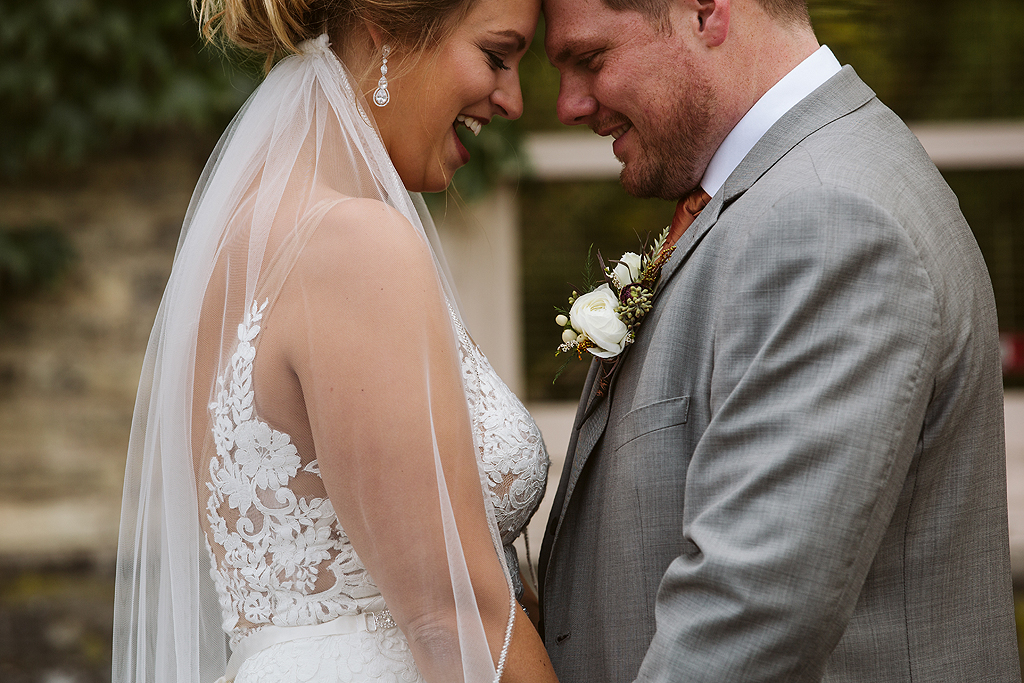 bride and groom laughing at the standard in rockford il
