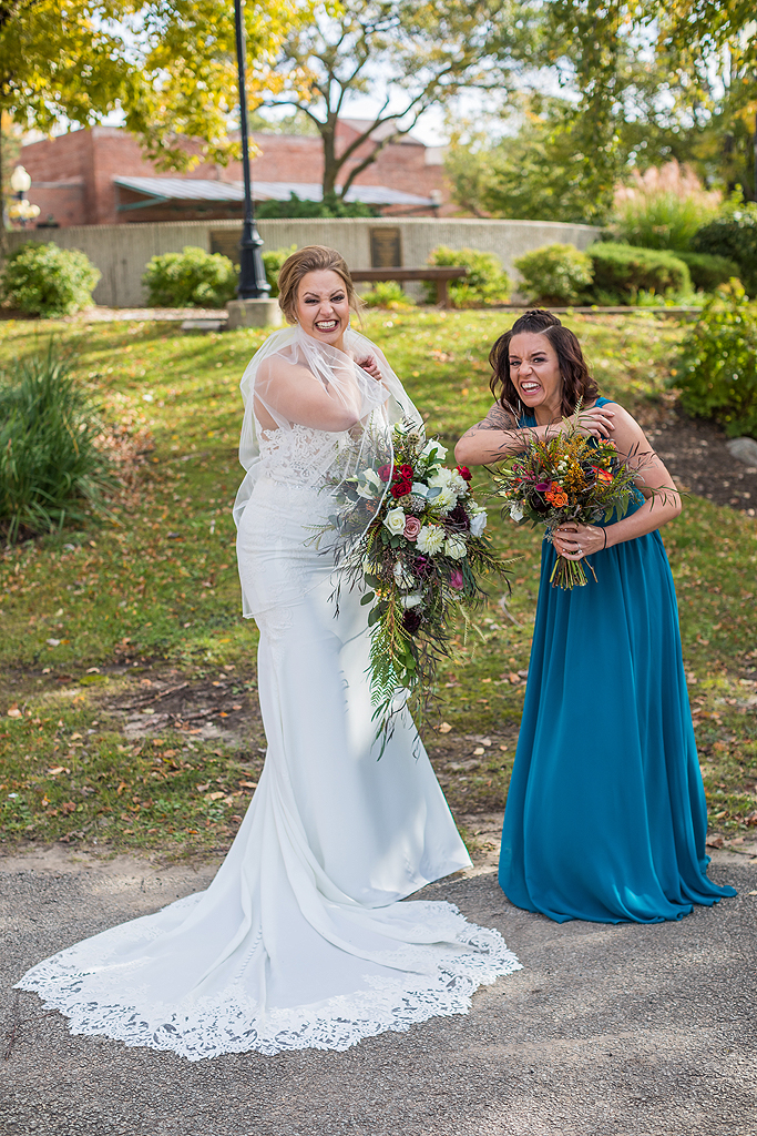 bride and bridesmaid hissing and laughing