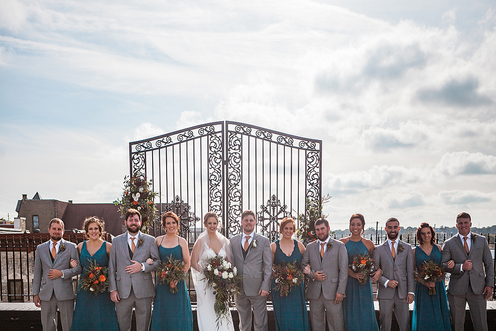 wedding bridal party on the roof of the standard in rockford il