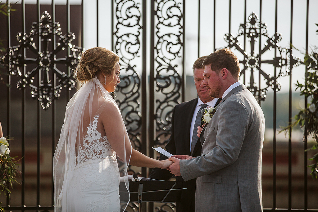 bride and groom exchanging vows during their wedding at the standard in rockford il
