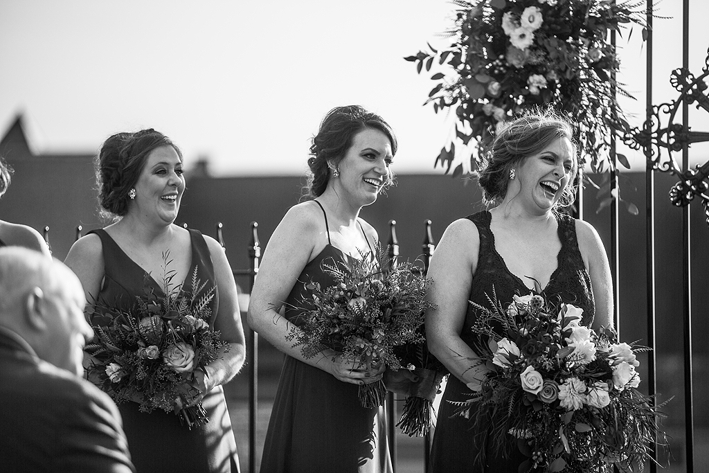 bridesmaids laughing during a wedding ceremony