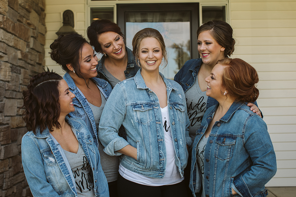 bride and her bridesmaids with jean jackets