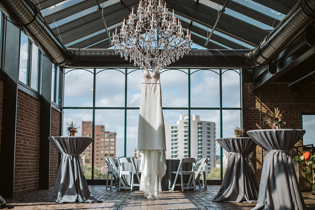 brides dress hanging in the standard overlooking rockford il