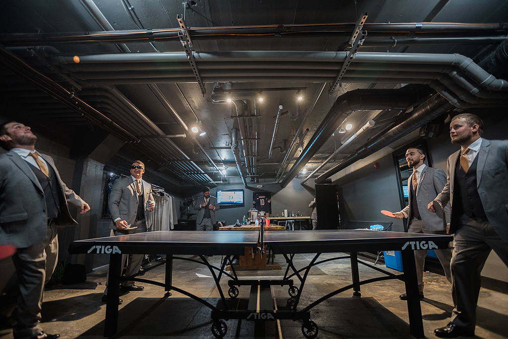 groomsmen playing ping pong at the standard