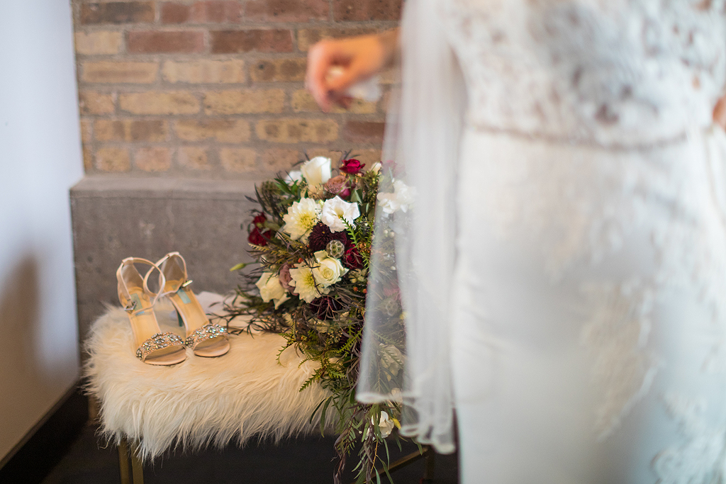 shoes and flowers of bride in the bridal suite at the standard