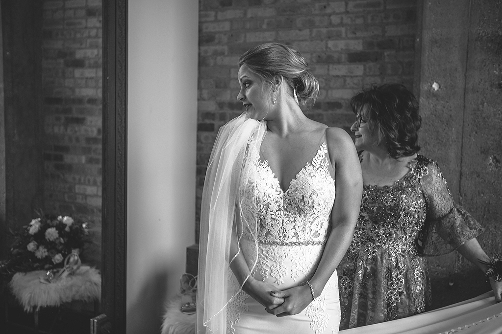 bride looking into mirror at the standard in rockford il
