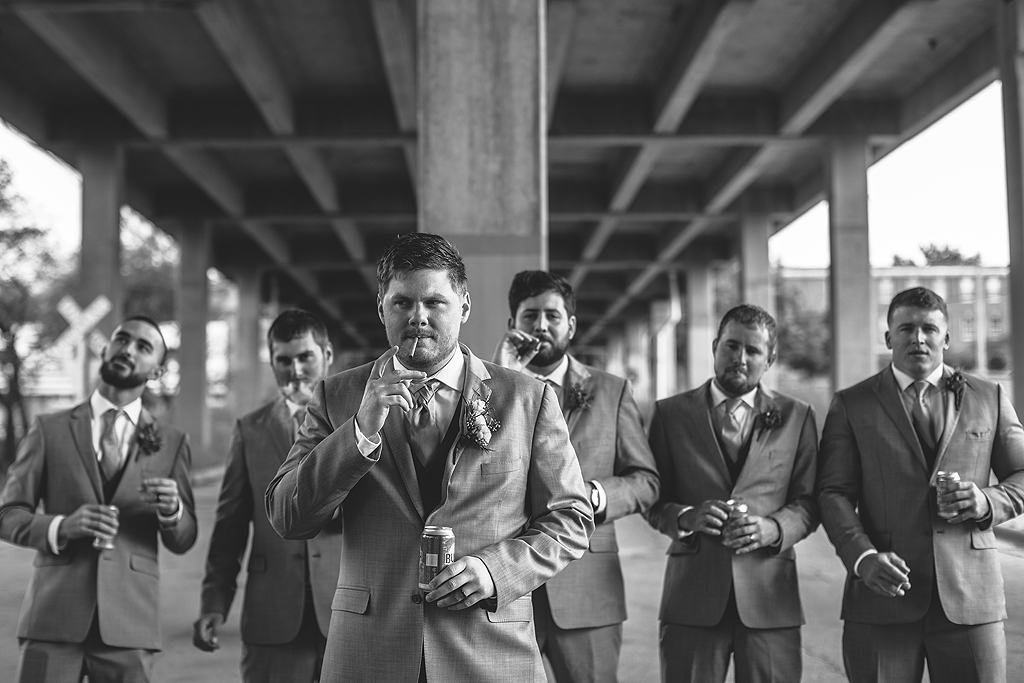groom with his groomsmen smoking