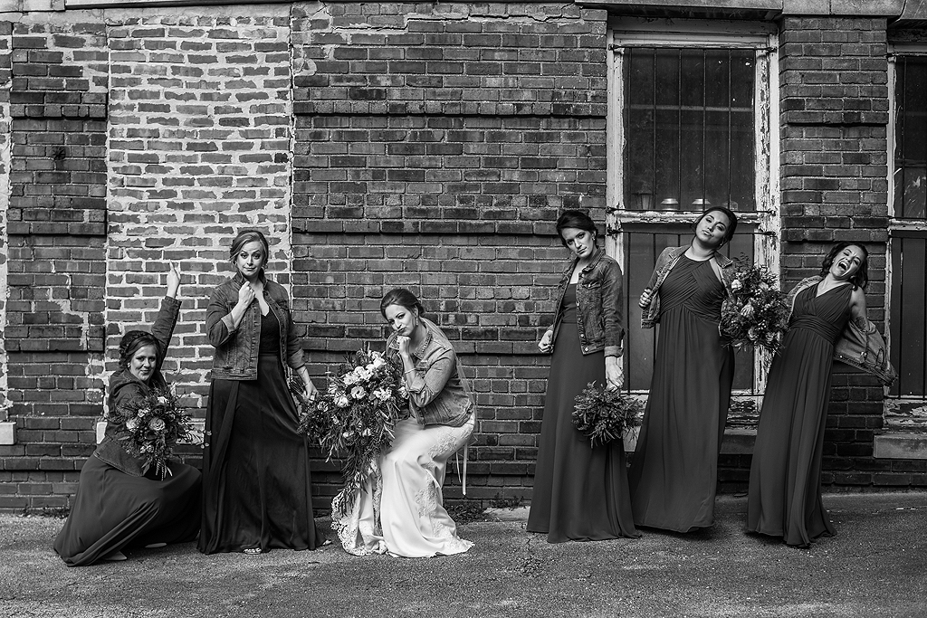 bridesmaids along brick wall in rockford il