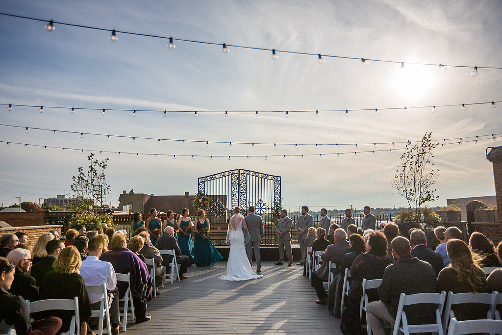 wedding ceremony on the roof at the standard in rockford il