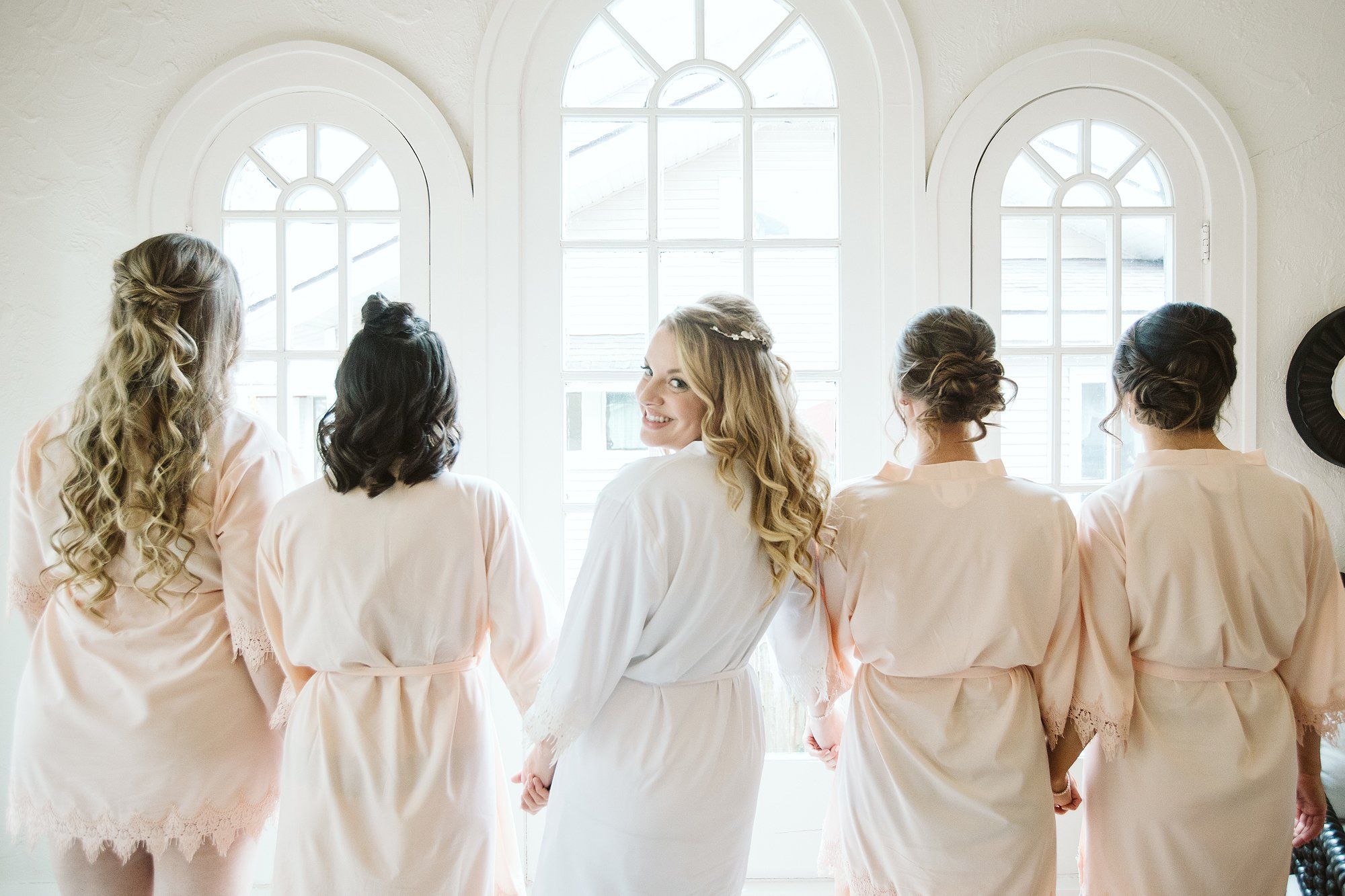 bride and her bridesmaids getting ready on her wedding day