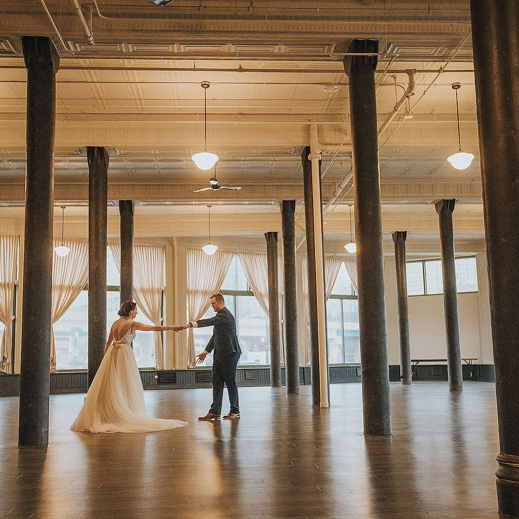 bride and groom dancing at their wedding in the pritzlaf in milwaukee wisconsin