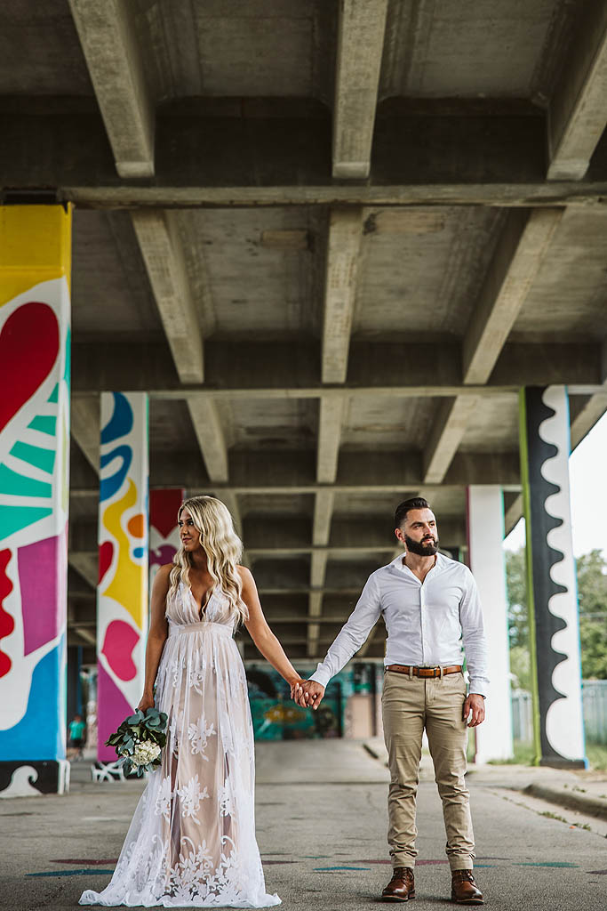 couple holding hands during their engagement photography session
