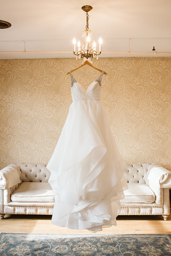 brides dress hanging in the bridal suite at The Haight in Elgin Illinois