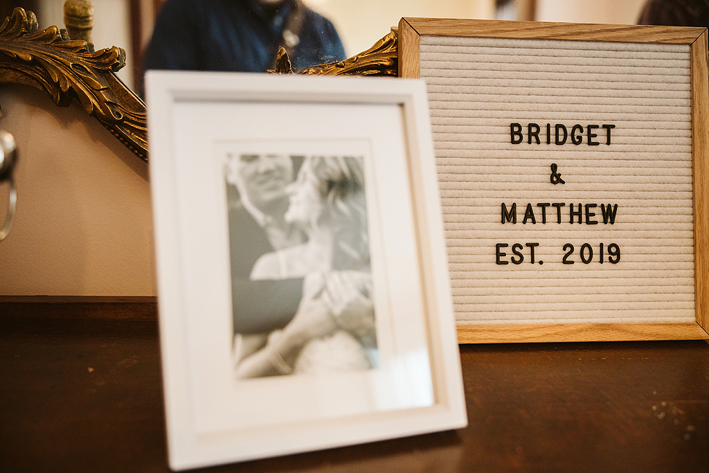engagement photo in frame on wedding day