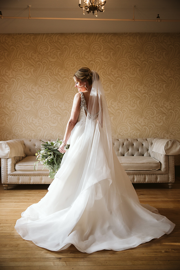 bride looking her flowers in the bridal suite at The Haight in Elgin Illinois