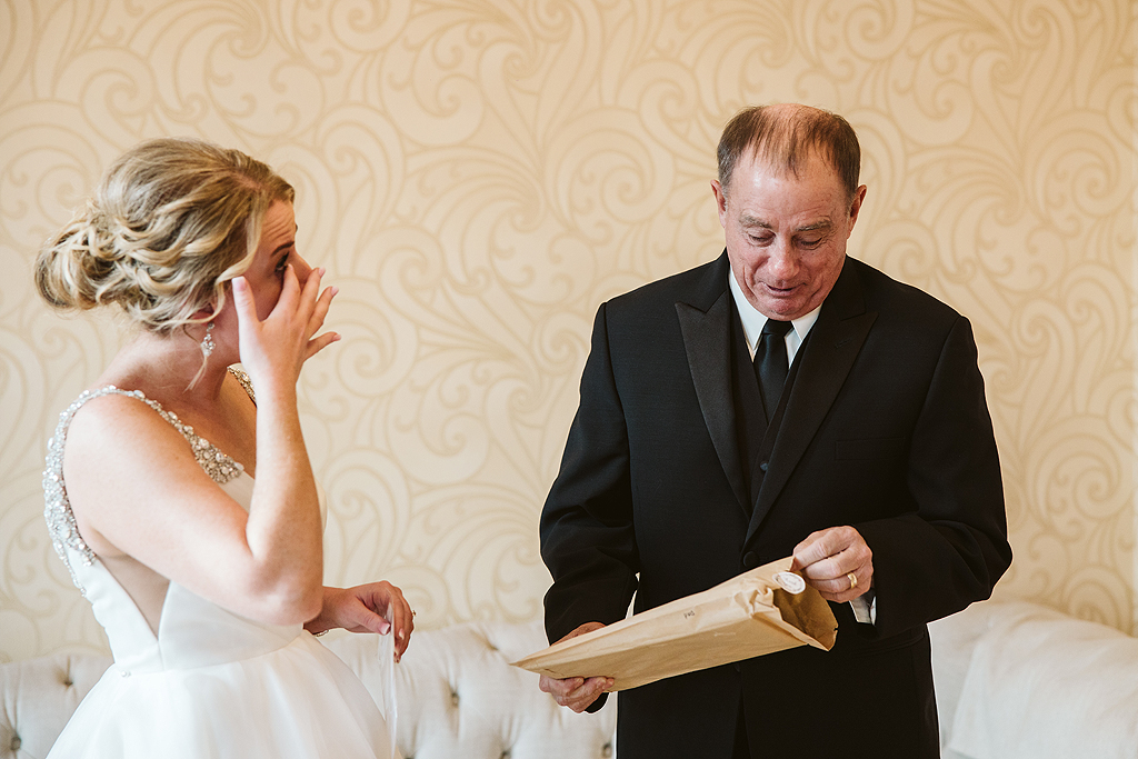 bride seeing her dad for the first time on her wedding day at The Haight in Elgin Illinois