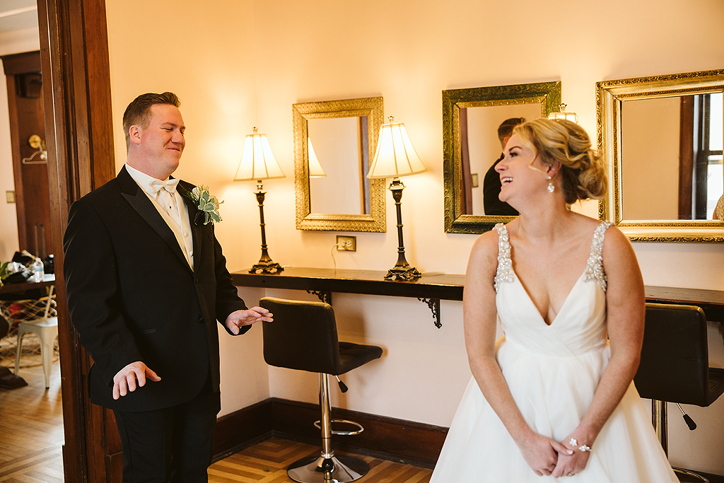 bride and groom share their first look at The Haight in Elgin Illinois