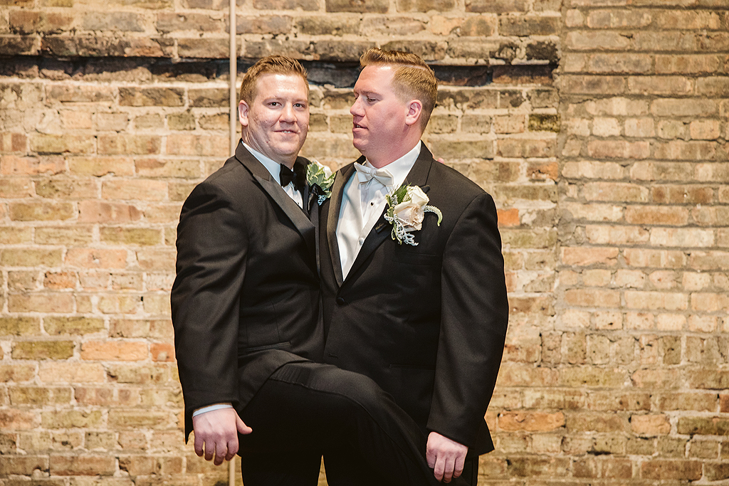 groom and groomsmen acting silly at The Haight in Elgin Illinois