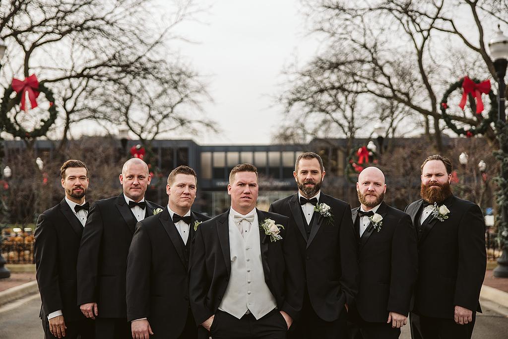 groom and groomsmen in downtown elgin illinois