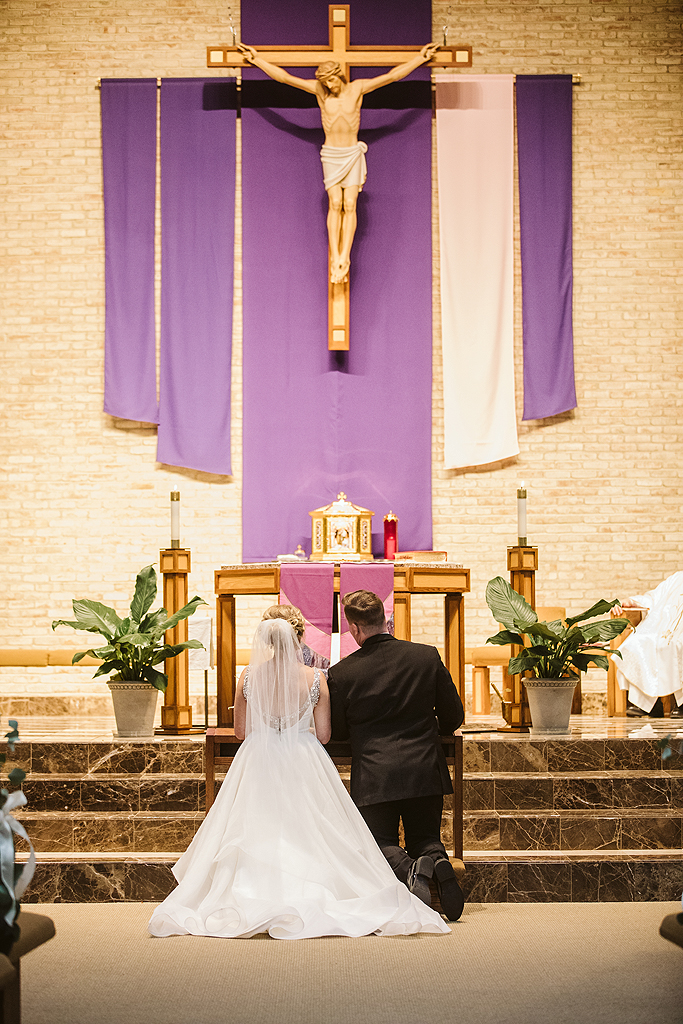 bride and groom at the church altar during their wedding