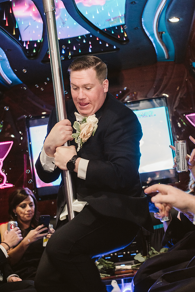 groom dancing on pole in party bus