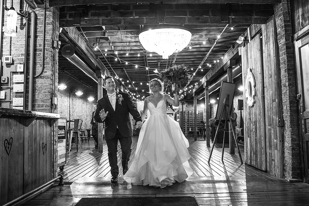bride and groom entering reception at The Haight in Elgin Illinois