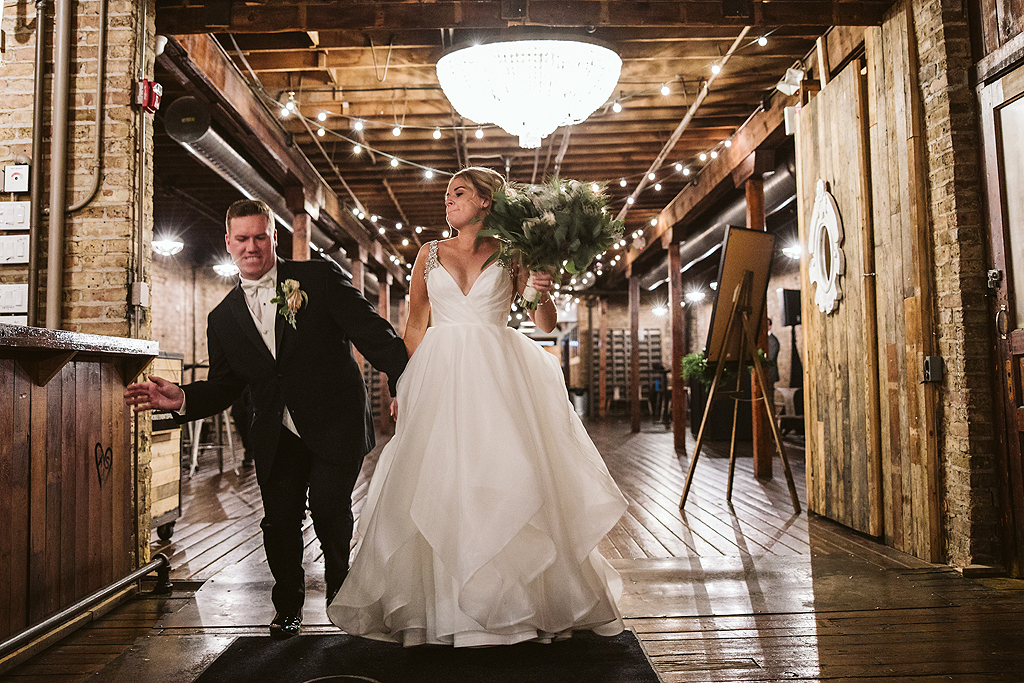 bride and groom dancing while entering into their reception at The Haight in Elgin Illinois