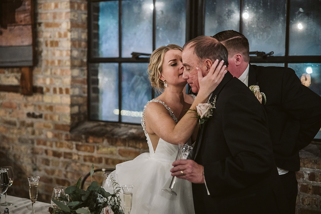 bride kissing her father during speech at The Haight in Elgin Illinois