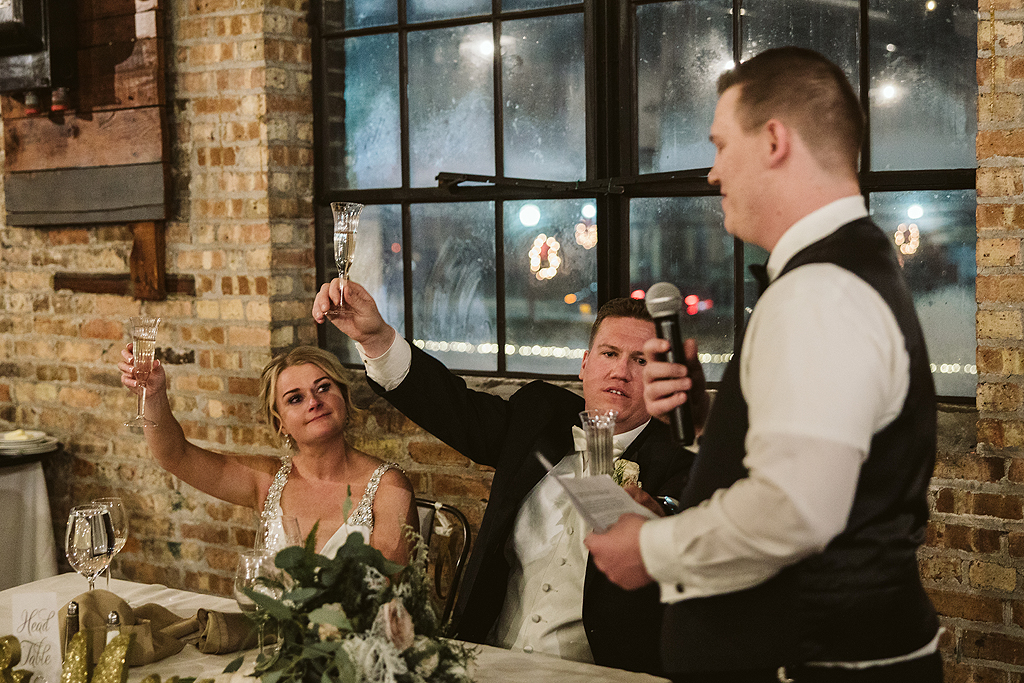 bride and groom sharing a toast at The Haight in Elgin Illinois