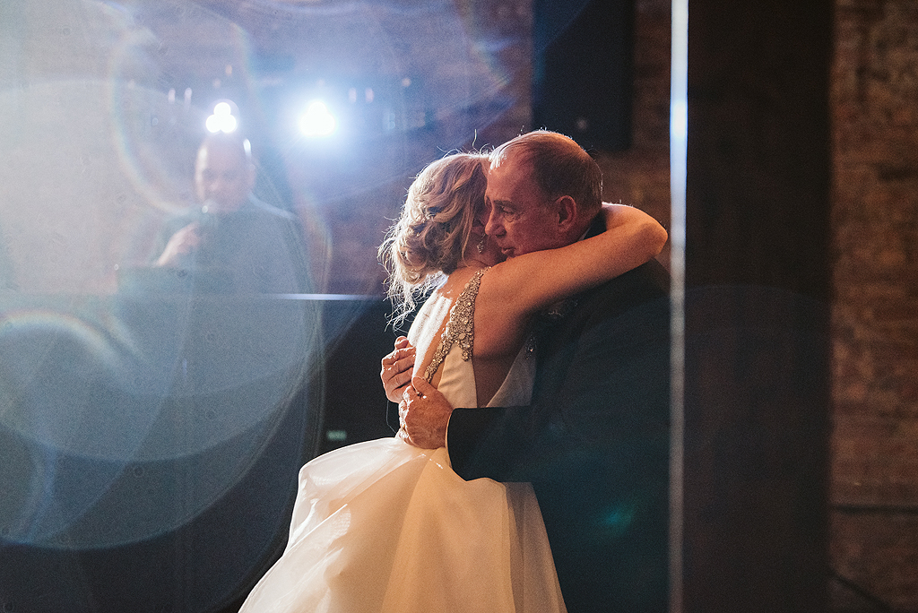 bride hugging her father at her reception at The Haight in Elgin Illinois