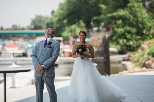 Bride seeing her groom for the first time at Prairie Street Brewing Company in Rockford IL
