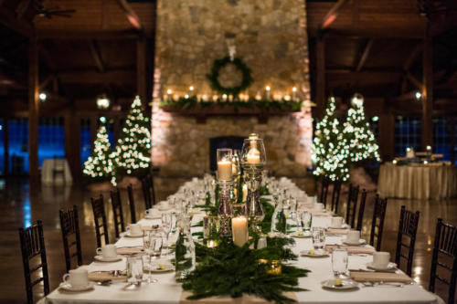 Winter wedding head table at wedding reception in Orchard Ridge Farms the Pavilion in Rockton Illinois