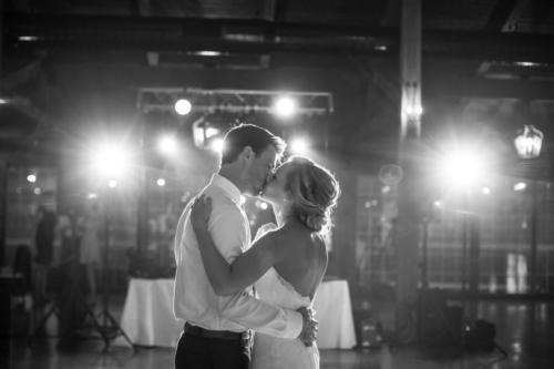 bride and kissing during their first dance
