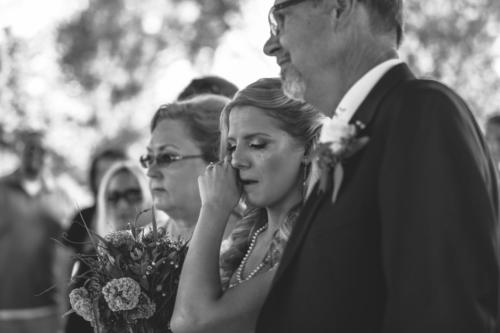 bride crying when she sees her groom on their wedding day
