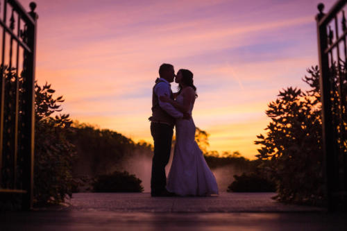 bride and groom at sunset Orchard Ridge Farms the Pavilion in Rockton Illinois
