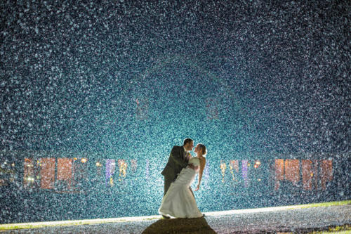bride and groom in the rain at Orchard Ridge Farms the Pavilion in Rockton Illinois