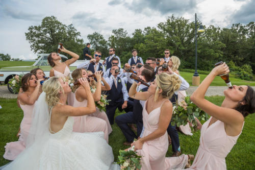 entire bridal party drink beer at a wedding