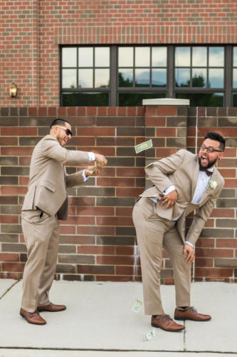 best man throwing cash at groom