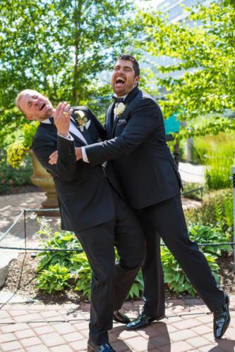 groomsmen kissing groom