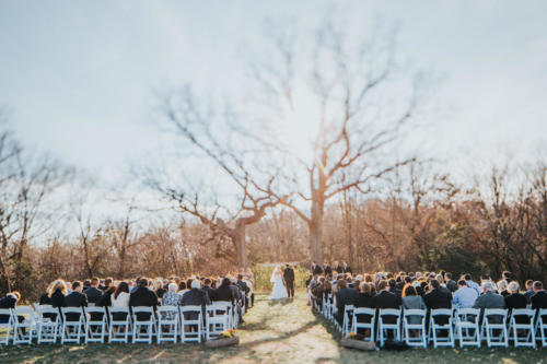 outdoor winter wedding ceremony at Orchard Ridge Farms the Pavilion in Rockton Illinois