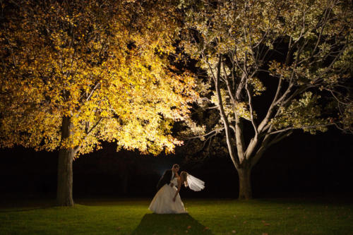 groom dipping bride at night in rockford illinois