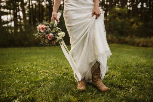 bride with cowboy boots and bouquet