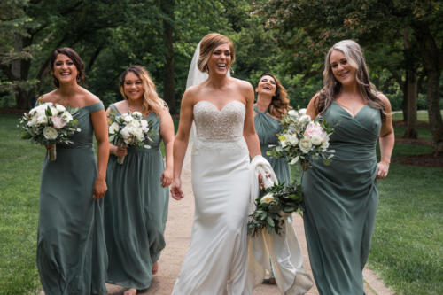 bride walking with bridesmaids