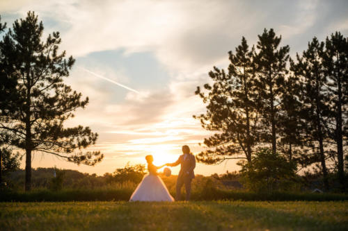 Bride and groom dancing in field at sunset at Orchard Ridge Farms the Pavilion in Rockton Illinois